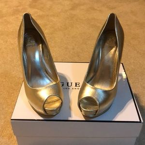 Gold leather GUESS open toed high heels.